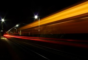 dockyard-station-and-passing-train-at-night-1-11