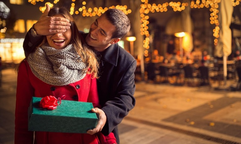 48434612 - man  keeps his girlfriend eyes covered while  she giving a gift , romantic surprise for christmas