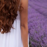 A young woman standing in a field of lavender